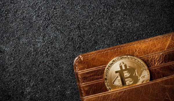 bitcoin-coin-in-wallet-on-black-background-PL66DFC-scaled.jpg